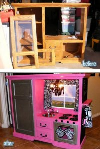 Discarded entertainment center coverted to kids play kitchen
